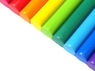 Colorful kid's plasticine on white background