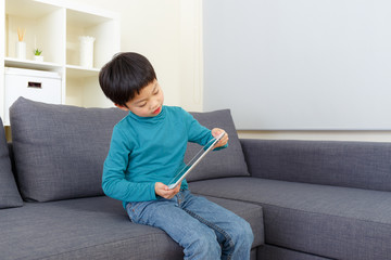 Little boy play game on tablet