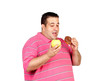 Fat man deciding between an apple and a sweet