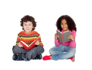 Two children sitting on the floor reading