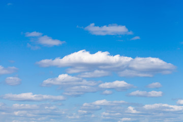 little fluffy white clouds in blue sky