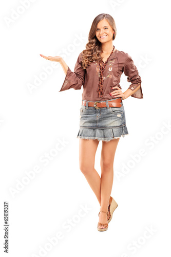 Happy fashionable female gesturing with hand