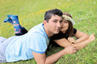 Young couple lying on grass in a meadow