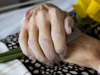 Closeup of a dead womans folded hands