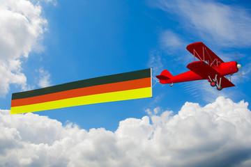 Doppeldecker mit Deutschlandfahne