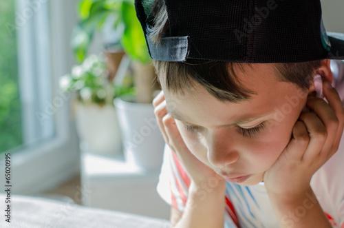 Leinwanddruck Bild Junge mit Kopfhörer
