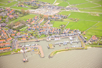 View at harbor of historic island of Marken from above