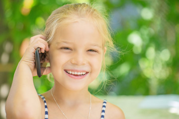Little girl talking on cell phone