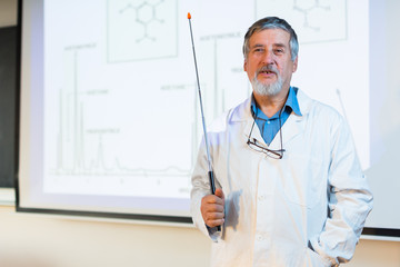 Senior chemistry professor giving a lecture in front of class