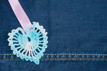 Crochet heart on a blue jeans background