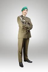 Soldier in uniform posing in studio for figure photos