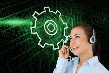 Composite image of cog and wheel with call center worker