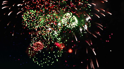 Colorful fireworks at holiday night.