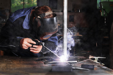 Welder With Protective Face Mask At Work