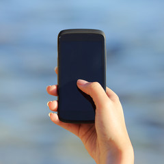 Woman hand holding and showing a blank smart phone screen