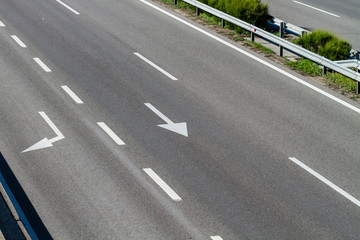 arrows on asphalt showing traffic where to go