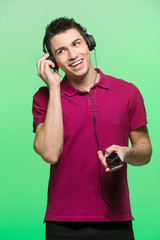 attractive young man listening music.