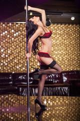 Fashion shoot of Sexy pole dancer in beautiful underwear.