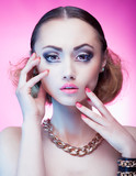 Face close up of beautiful young woman wearing jewellery - 65031784