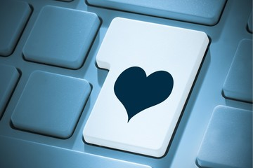 Composite image of heart on enter key