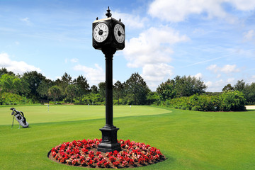 Outdoor Clock Post on golf course with green spring valley