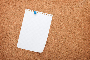 Blank notepad paper on cork wood notice board