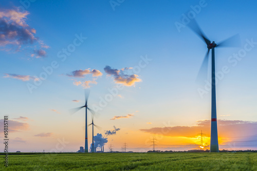 Windpower with brown cole power station at sunset - 65035781