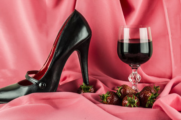 wine, strawberries and women's shoes