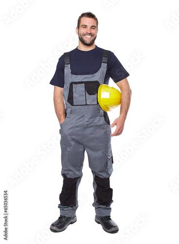 Portrait of smiling worker in gray uniform - 65036534