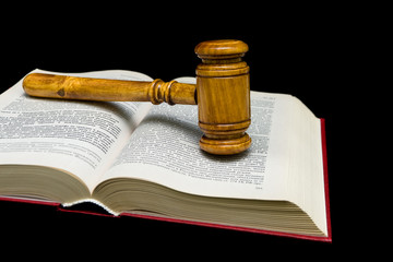 judges gavel and law book on a black background