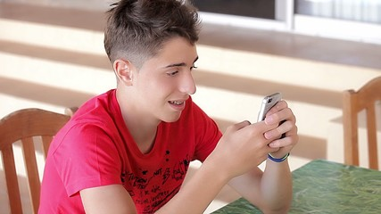 Teenager writing messages on the smartphone