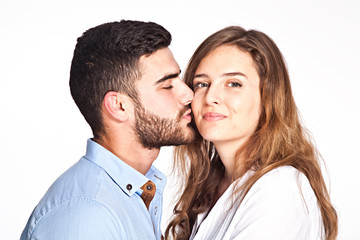 Happy mixed-race couple kissing isolated on white background