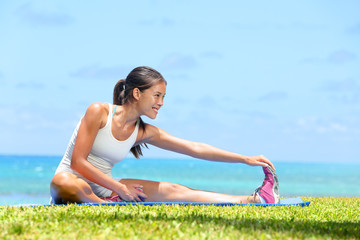 Woman stretching legs exercise training fitness