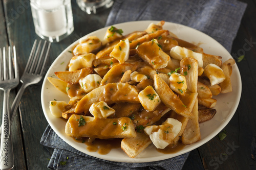 Poster Unhealthy Delicious Poutine with French Fries