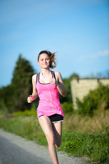 fitness sport healthy cheerful young woman running outdoor