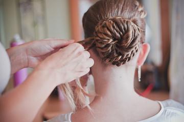 Stylist weaves braid