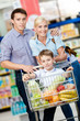 Family drives cart with food and son sitting there