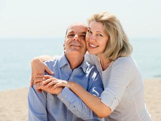 elderly couple spends time on seaside