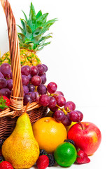 Variety of fresh fruits in wicker basket