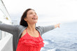 Cruise ship woman on boat in happy free pose