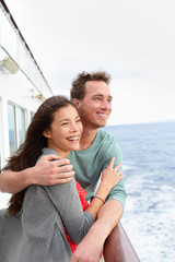 Cruise ship couple romantic on boat embracing