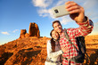 Selfie - Happy couple taking self portrait hiking