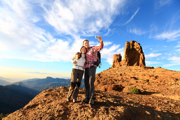 Couple taking selfie hiking in beautiful nature