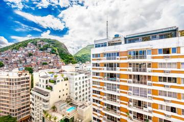 Favela, Brazilian slum on a hill behind a residential area in Ri