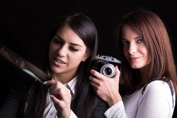 Beautiful women making photos with old vintage analog cameras