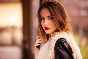 Gorgeous brunette standing on the train station portrait