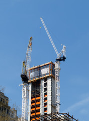 Cranes on top of new building