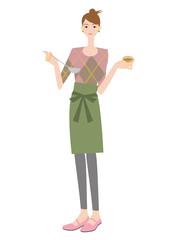 料理の味見をする主婦