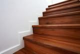 wooden staircase in a white modern house - 65054377
