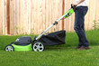 Man cutting the grass with lawn mower - 65054742